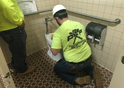 Man working on the water for the bathrooms