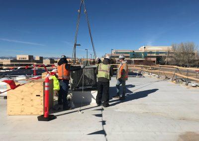 Men helping lift an object