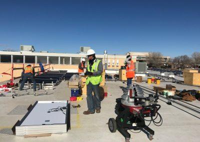 Men installing solar panels