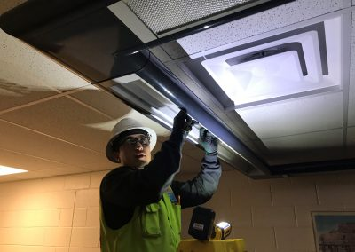 Man installing lighting