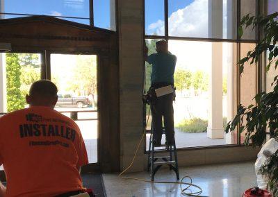 Man working on a window